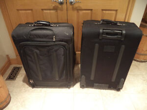 2 large suitcases $20.00 each obo