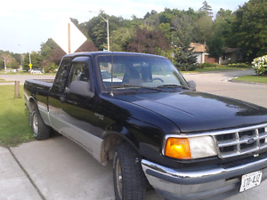 1993 Black and silver Ford Ranger Small pickup truck