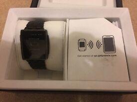 Pebble steel smart watch.