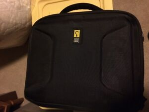 Carrying case for a portable DVD Player for rear seat of vehicle