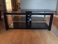 3 tier smoked glass TV stand for sale.
