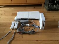 Nintendo Wii with wii fit board and 2 controllers and 8 games