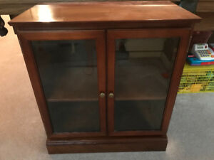 Cherry cabinet with glass doors and middle shelf
