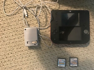 Crimson red Nintendo 2ds with three games