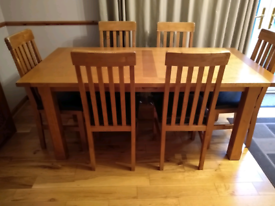 Solid oak dining table with matching sideboard