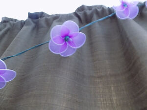 String lights with purple flowers
