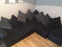 Corner sofa and footstool black and grey