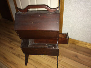 Antique wooden sewing cabinet