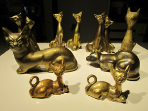 Collection of brass cats figurines.