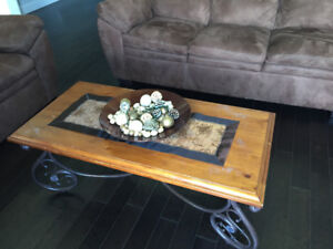 Coffee table with 2 identical end tables and lamps.