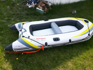 Inflatable boat used twice.