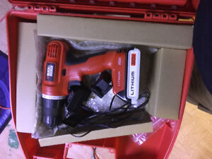 Fairly New 20v black and decker drill driver kit with dewalt bit
