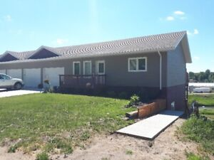 New 1240 sq. ft. 2 bedroom apartment with attached garage