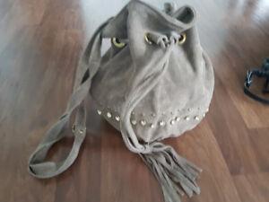 A studded suede bucket handbag