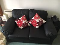 Pair of black leather sofas