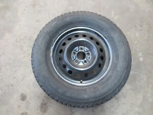 "4 Firestone Winterforce P245/70/17"" Snow Tires on Wheels."