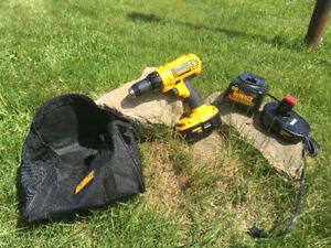 Dewalt drill with two batteries, charger and bag.
