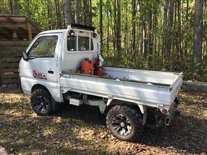 suzuki 4x4 mini truck  4in lift quad wheels and new tires