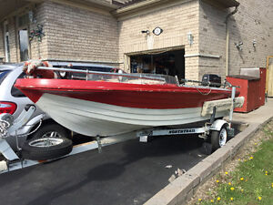 14ft Bayliner outboard 28hp Johnson with trailer