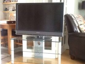 Sony hd TVs and glass stand