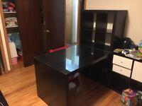 Black ikea desk and shelf with glass top.