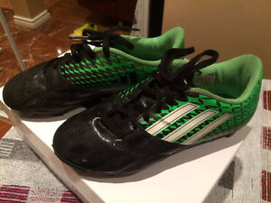 A pair of soccer shoes for boys