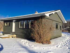 Affordable country property in beautiful Millarville!