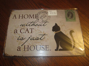 Home without a cat sign and other collectible tin signs