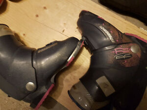 two pairs of boots for kids and women