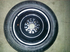 Spare Tire and Rim Great Condition Donut Style (Never Used)