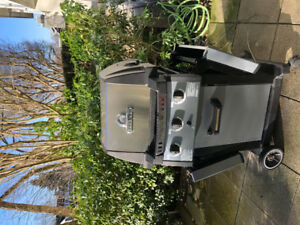 Free Broil King barbecue with cover and propane tank