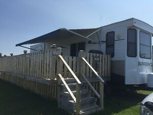 2012 Keystone Residence camper park model with deck