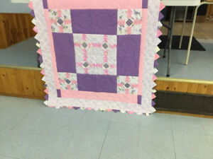 Hand made and hand quilted baby crib quilt