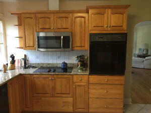 Birch kitchen cabinets with granite countertops and appliances