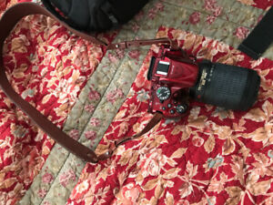 Nikon D5200 like new with bag, tripod and leather strap