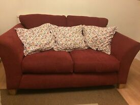 Dark red corduroy two - three seat sofa with Ikea cushions