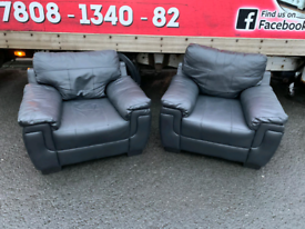 2 armchairs in black leather £70 a piece