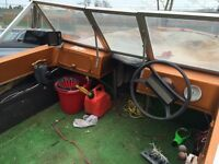 Boat motor trailer and fish finder