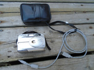 FujiFilm Digital camera with cables and case.