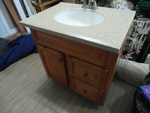 "30"" Oak Vanity with Corian sink top"