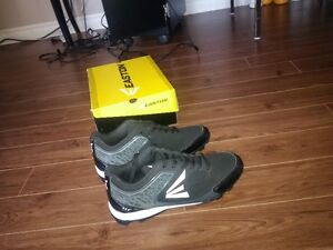 Brand new men's Easton 9.5 baseball cleats in box