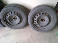 Steel rims with tires, TPMS sensors, hubs, and spare nuts
