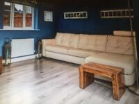 Cream leather 4 seater chaise sofa.