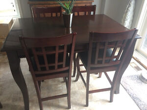 Kitchen table and 4 bar chairs with leaf chairs
