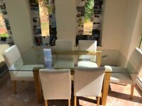 Next glass top, oak frame dining table and six chairs