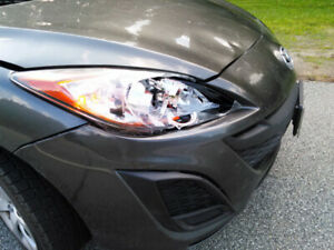 Looking for 2010 Mazda3 grey front bumper/pare-choc avant Mazda3