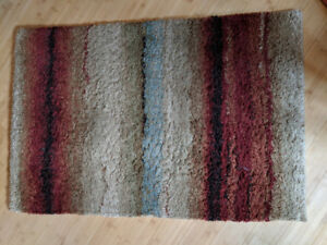 Area rugs  (2) - rust, green and blue colors