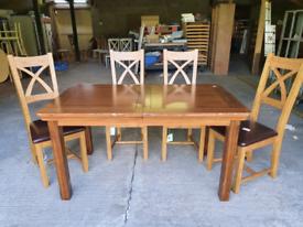 Oak Furniture Land Dark Oak 4-6 extending dinimg table 4 leather chair