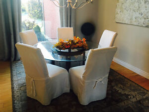 Glass table and set of 6 covered chairs