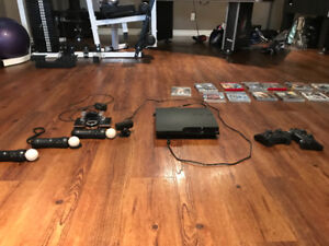 PS3 with 2 controllers and a move system